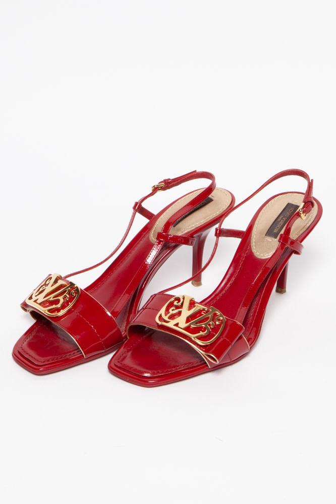Louis Vuitton Escarpins en cuir rouge avec logo doré