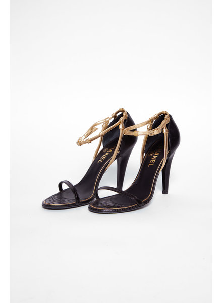 Chanel BLACK AND GOLD LEATHER PUMPS