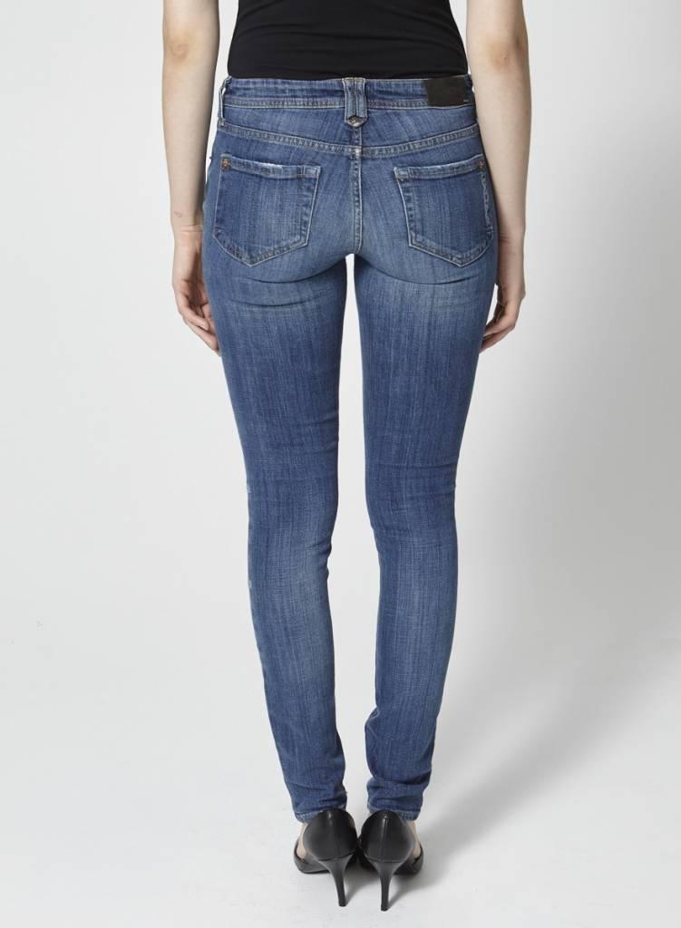 Jeans skinny bleu effet déchiré et paillettes