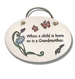 AUGUST CERAMICS OVAL PLAQUE FLOWER W/BUTTERFLIES: WHEN A CHILD...