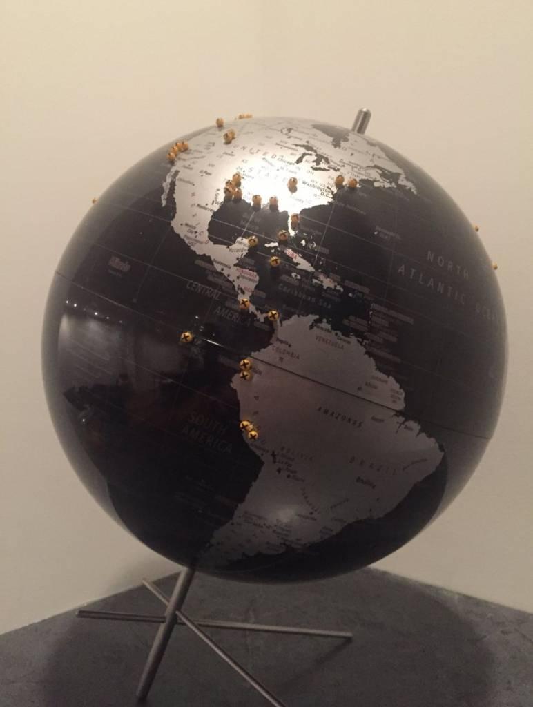 maptacks in a globe