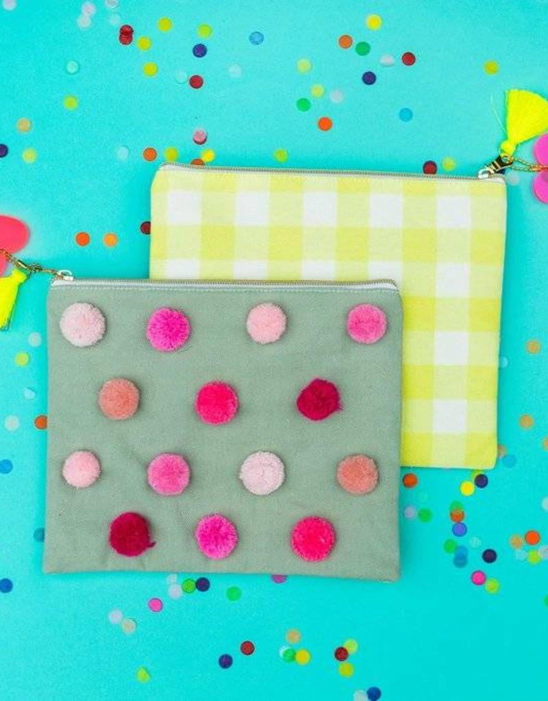 Taylor Elliott Designs gray pom pom pouch