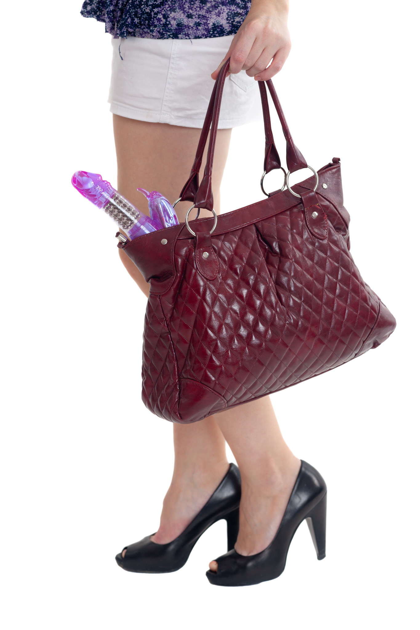Woman walking holding purse with vibrator visible inside