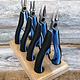 Lindstrom PL7897RX = Lindstrom RX 4 Piece Plier Set in Wood Stand