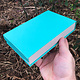 DBX4355 = Deluxe Magnetic Teal/White Necklace Box 4-3/4'' x 7-1/4'' x 1-1/8'' (Each)