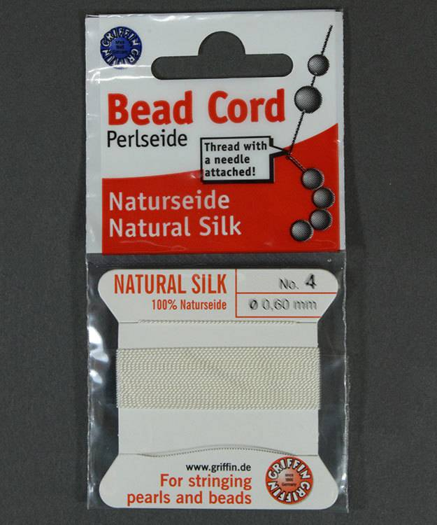 38.01204 = White Silk Beading Cord #4 on Card with Needle