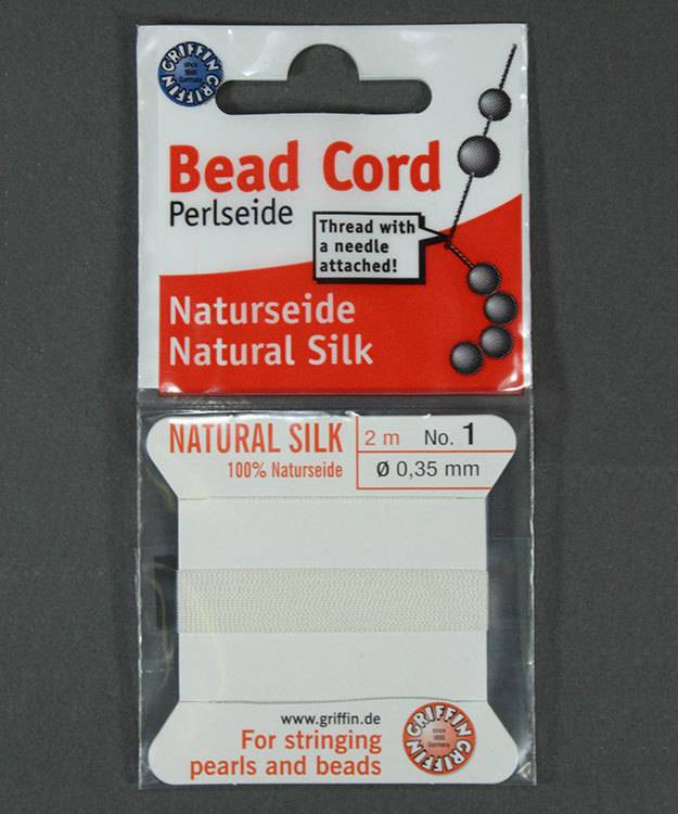 38.01201 = White Silk Beading Cord #1 on Card with Needle