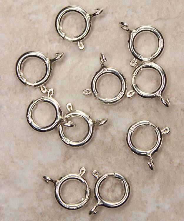 911S-05 = Sterling Silver Spring Ring 7mm Standard (Pkg of 10)