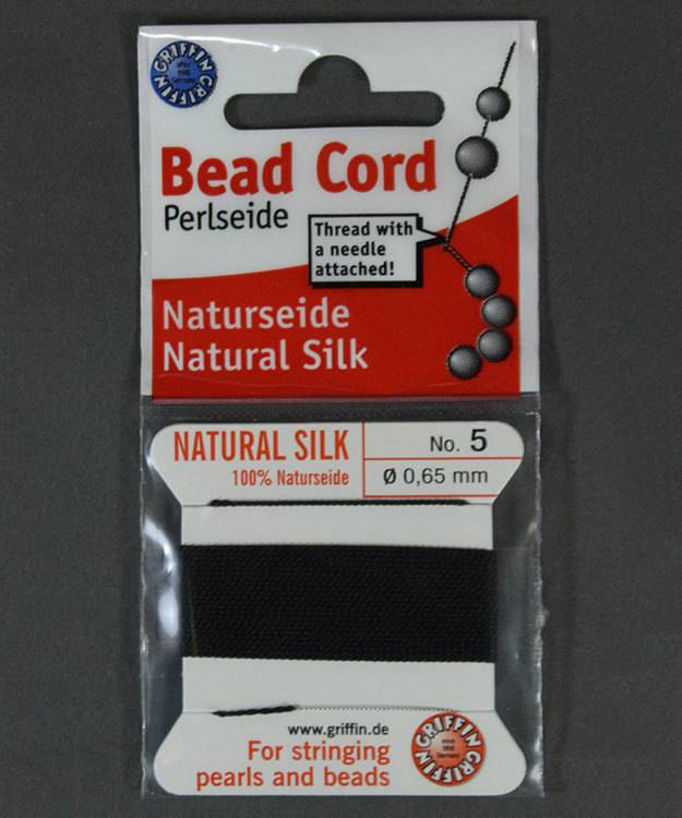 38.01215 = Black Silk Beading Cord #5 on Card with Needle