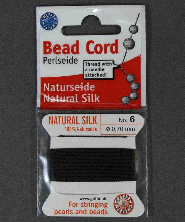 38.01216 = Black Silk Beading Cord #6 on Card with Needle
