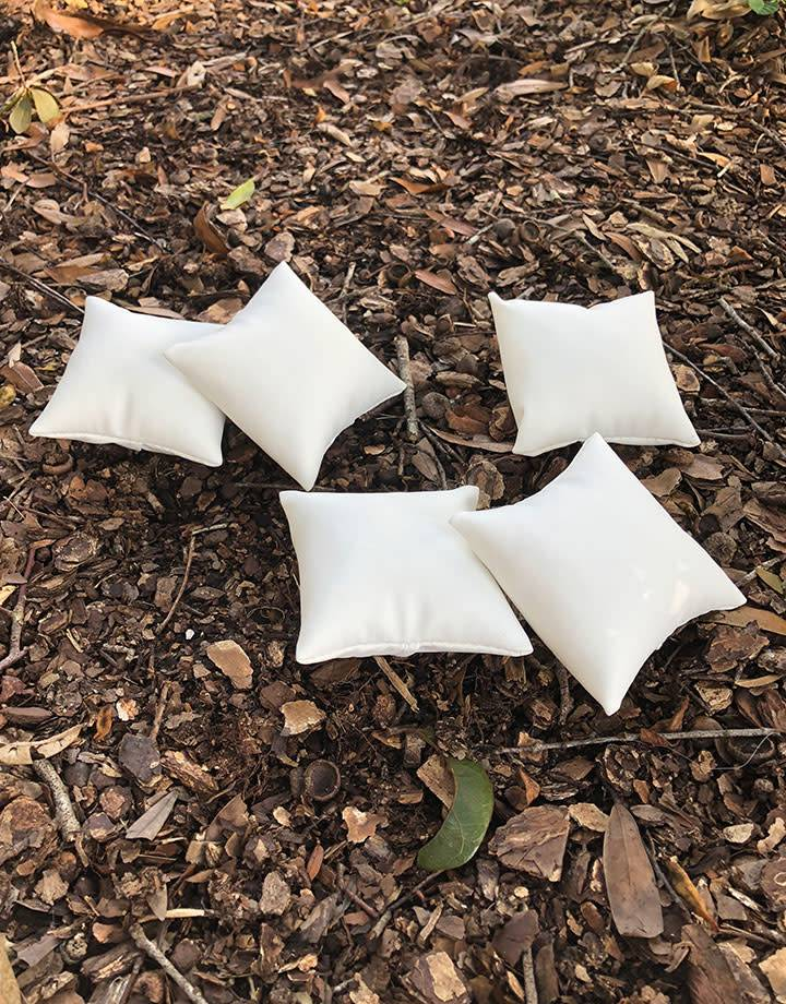 DIS6130 = White Leatherette Pillow for Watches or Bracelets 3''x3'' (Pkg of 5)