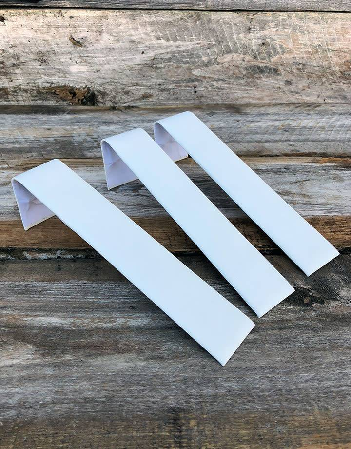 DBR6239 = White Leatherette Single Bracelet Ramp 1-1/2'' x 7-3/4'' (Pkg of 3)