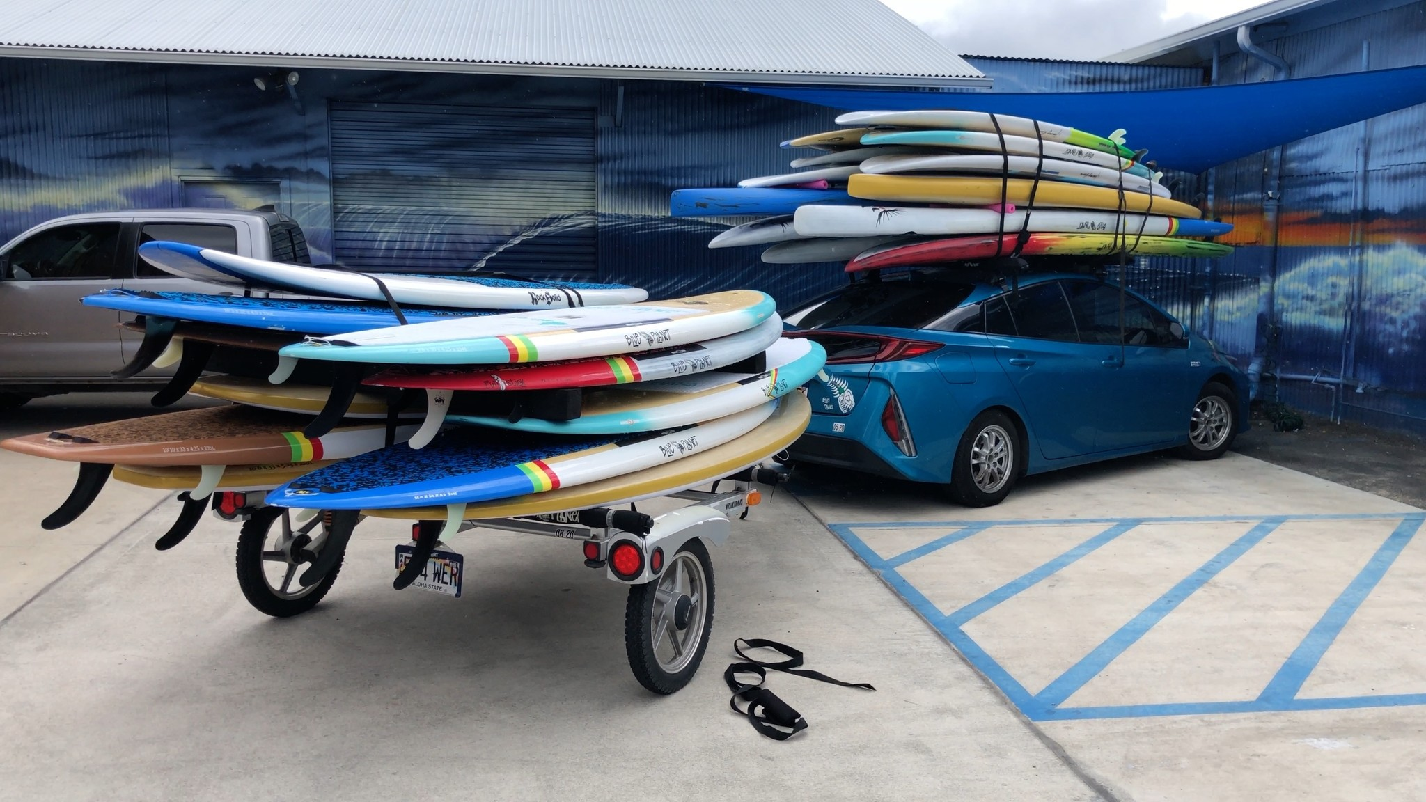 prius loaded with SUP boards how to strap board to car