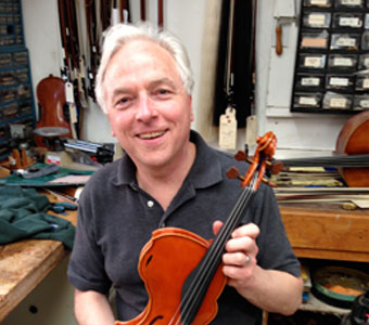 David Rivinus, innovator and maker of ergonomic asymmetrical violins and violas, at Metzler's on April 18, 2013.