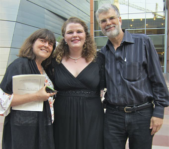 Julia Metzler with parents, after doing well singing at the Metropolitan Opera Regional Finals.