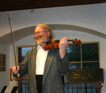 Violinist David Stenske compares violins at Metzler's annual Italian Violin sale on January 9, 2005.