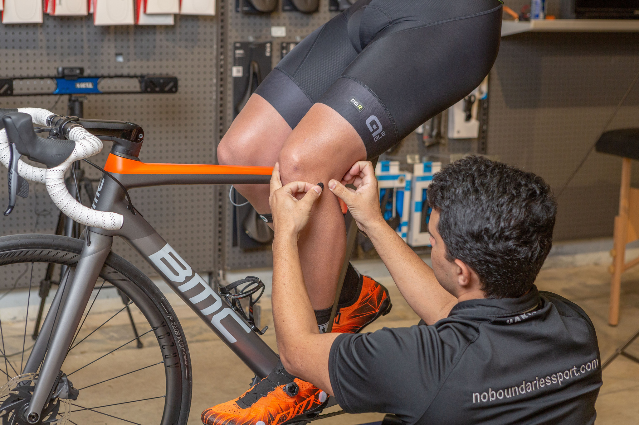 man touching a cyclist knee