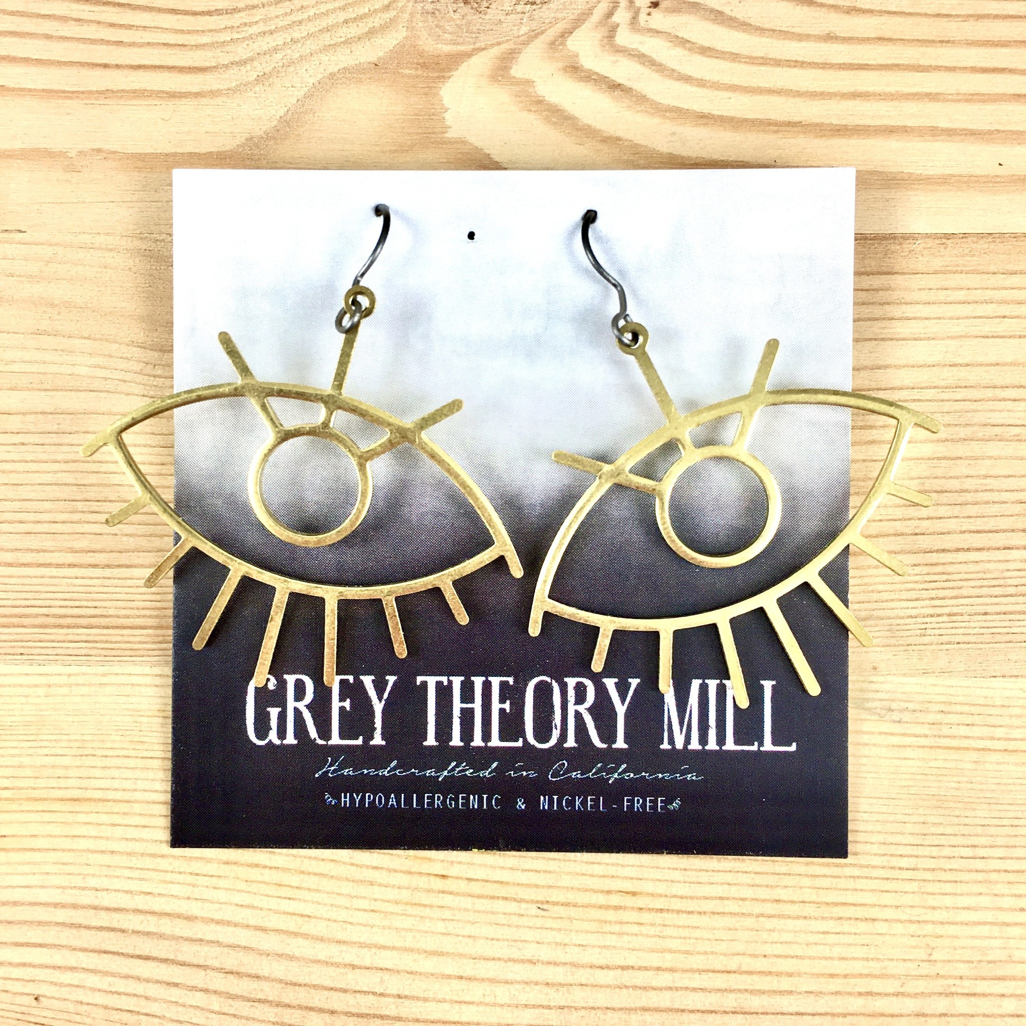 Grey Theory Mill Gold Eye Dangle Earrings