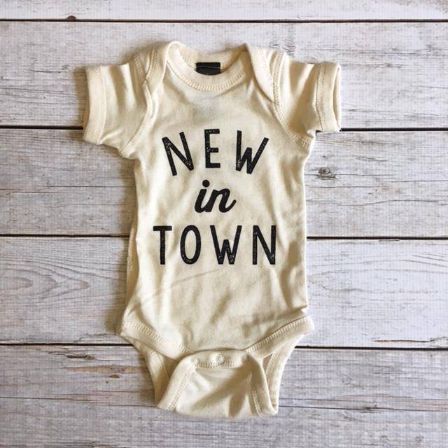 The Oyster's Pearl The Oyster's Pearl | New In Town Onesie