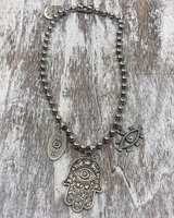 4 Soles Hamsa Necklace