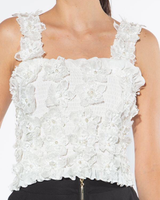 Sleeveless top with floral appliques with pearls