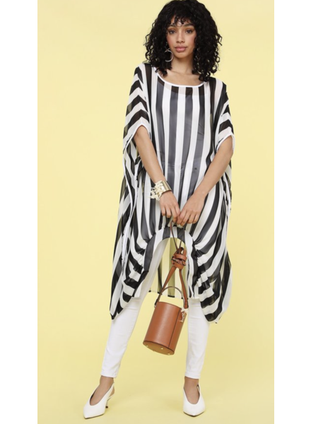 Solid loose fit poncho with an asymmetrical hem, color blocking