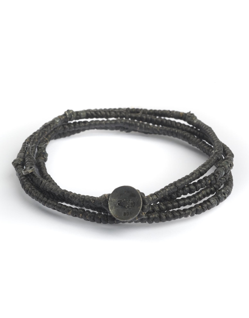 Four wrap waxed cord with oxidized silver skulls