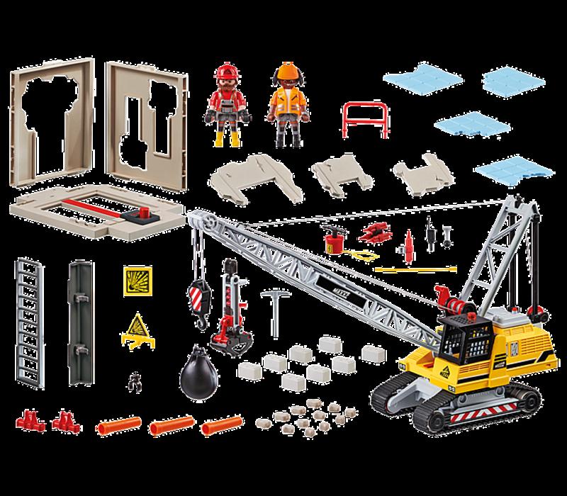 Dragline avec mur de construction
