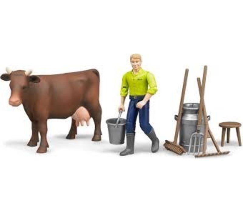 Figurine avec vache et accessoires