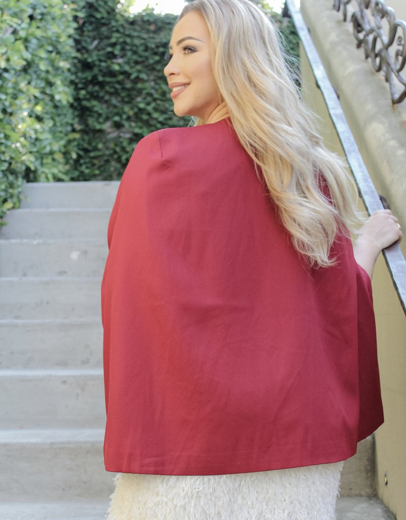 The Radiant in Red Cape