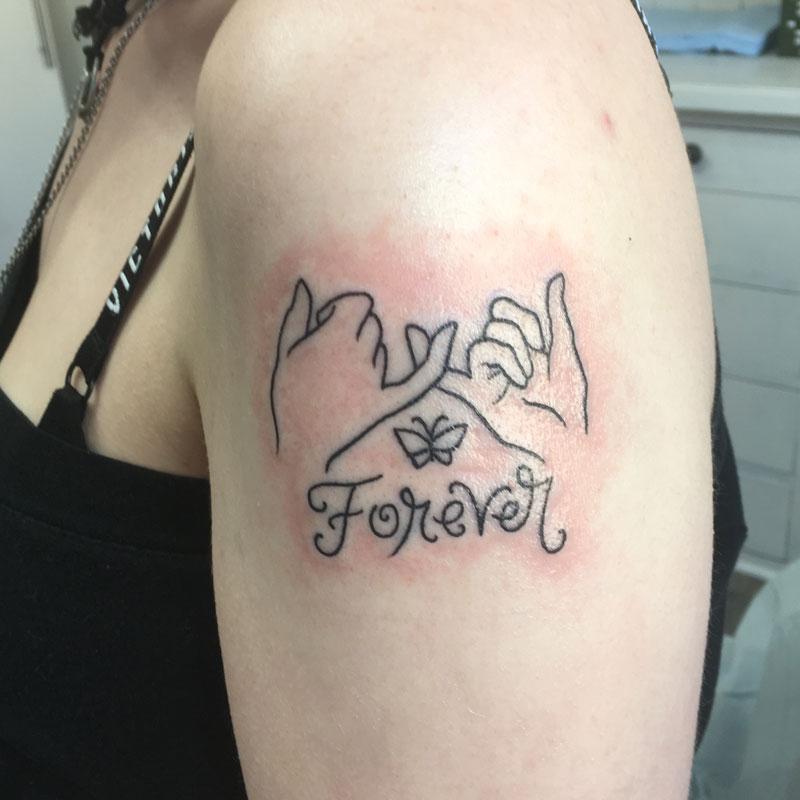 Pinky tattoo
