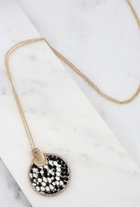 Carsyn long necklace with cz lined animal print round pendant snake black