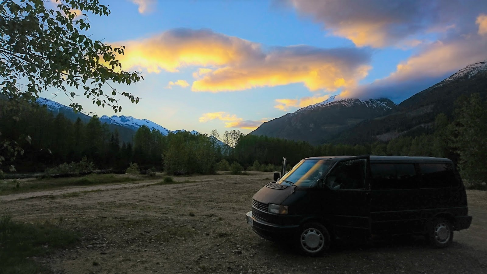 Eurovan parked in the moutains at sunset