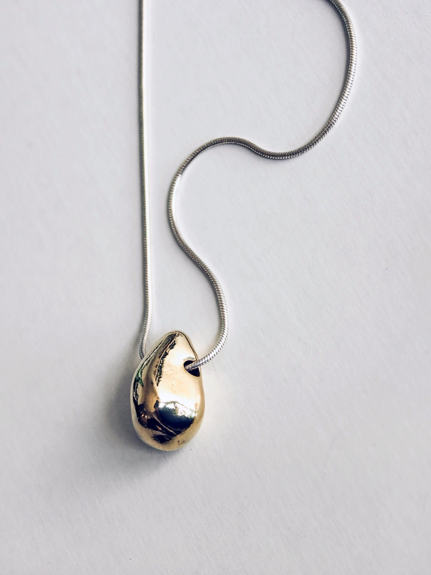 L.L.Y. Altelier Large Bean Necklace: Brass and Sterling Silver