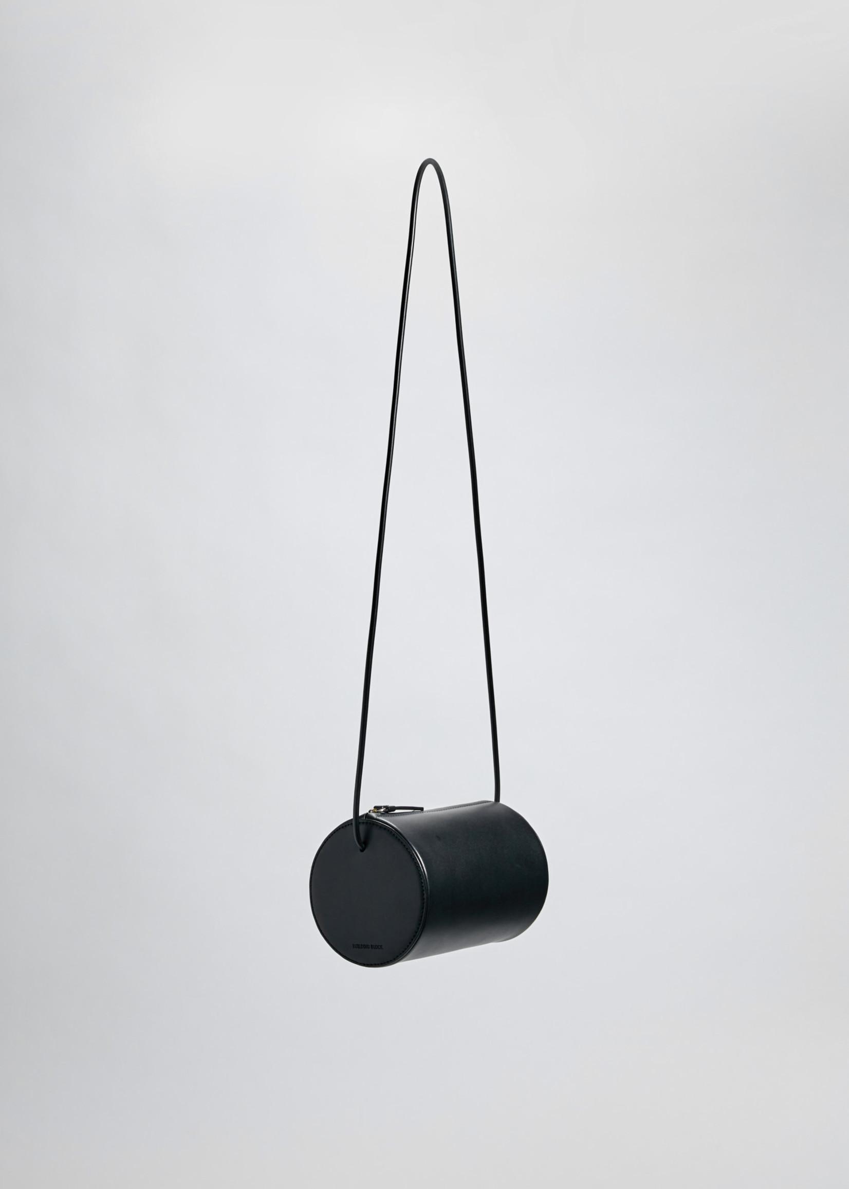 Building Block Cylinder Sling in Black Leather