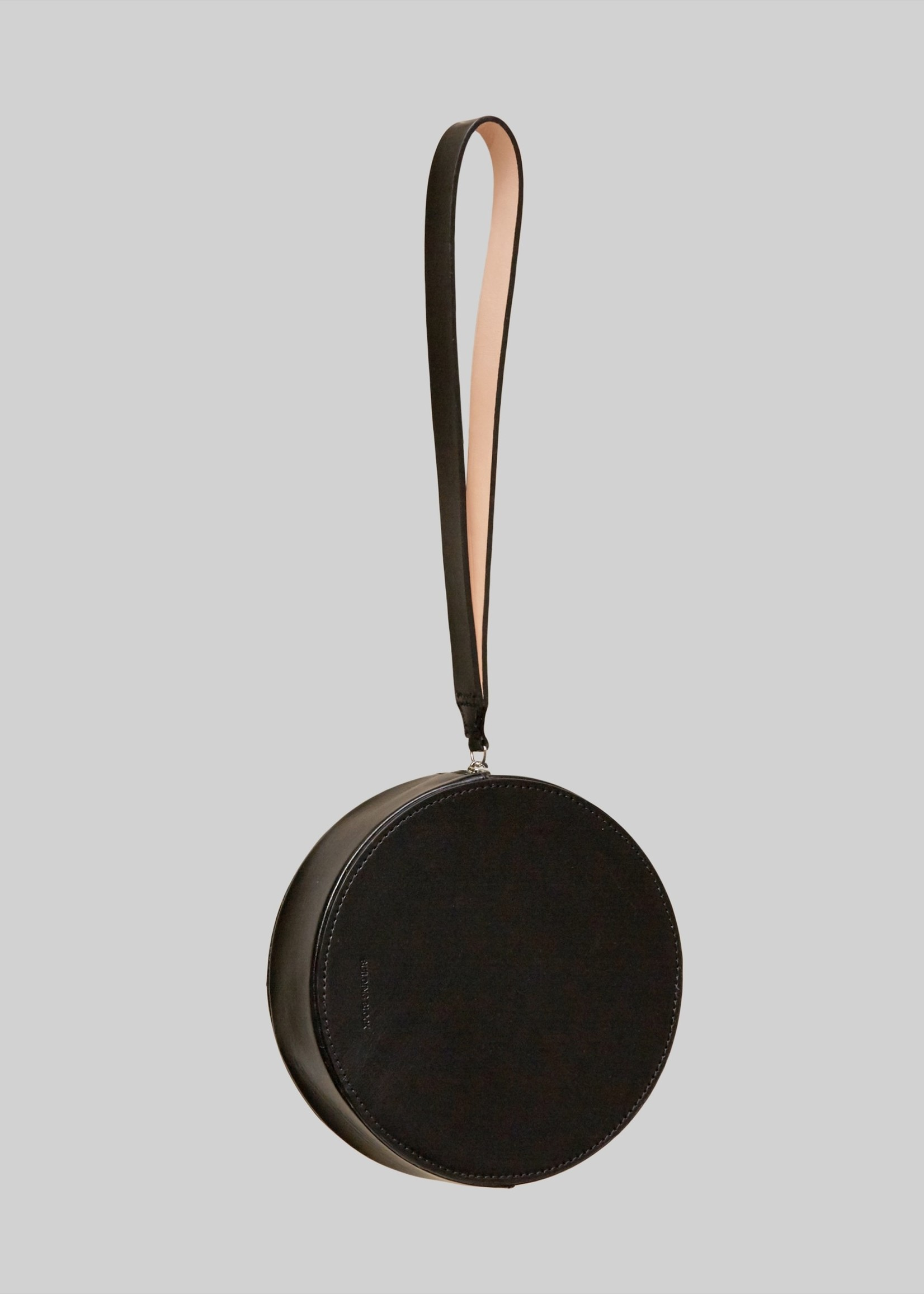 Building Block Puck Round Wristlet in Black Leather