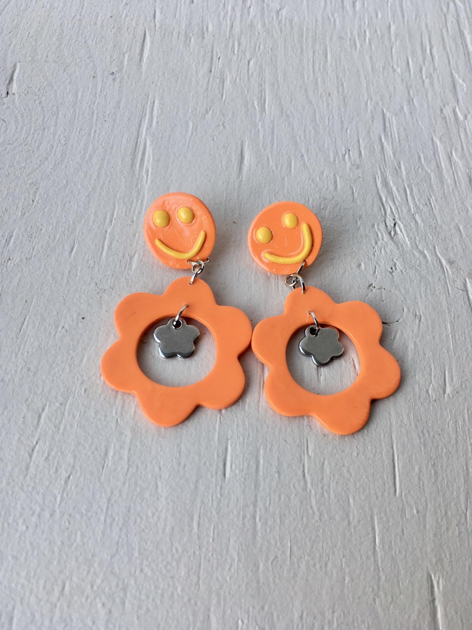 Emma Jewels Orange Smileys With Flower Dangle