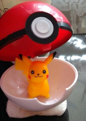 collage Poke Ball with Figurine