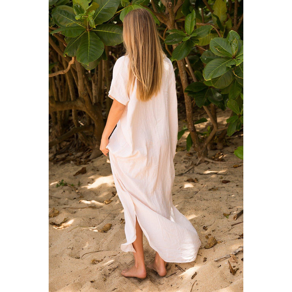 Acacia 100% Cotton button up dress with a slit in the sides and front.