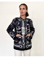 COLLARLESS REVERSIBLE SILK PRINTED QUILTED JACKET: STIRRUPS-CHAINS