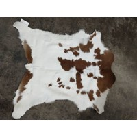 Brown and White Calfskin Rug