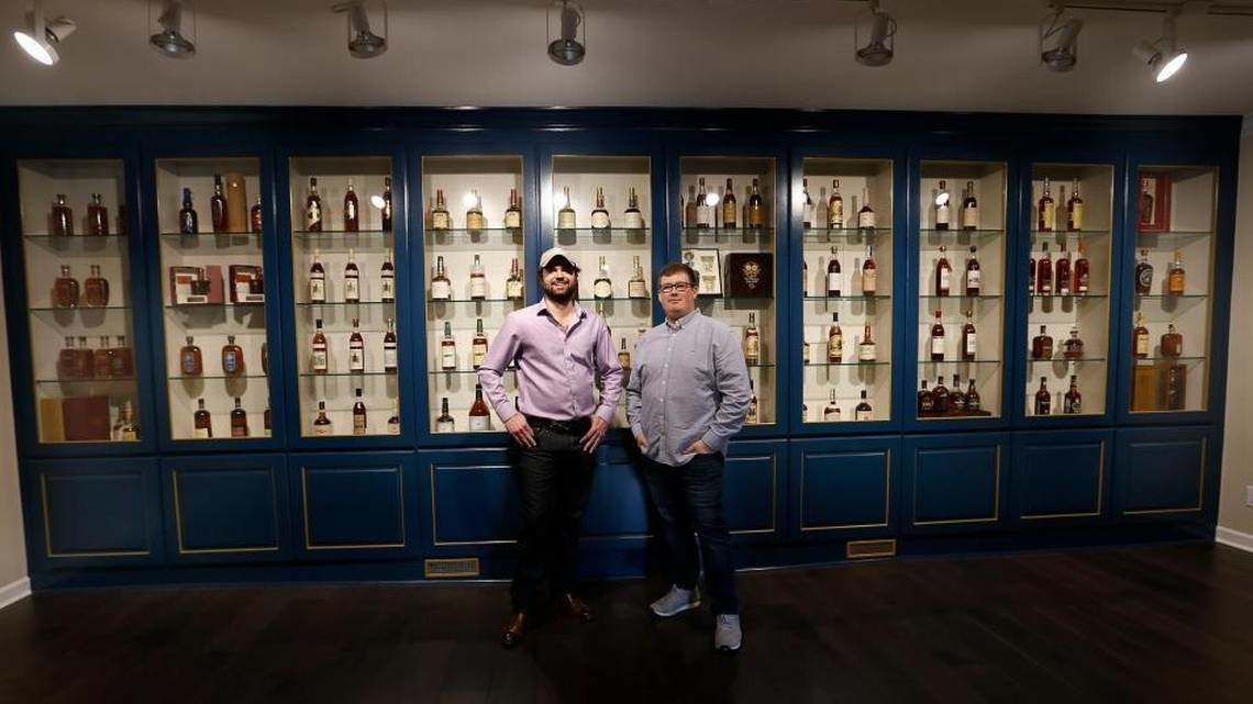 Justin Thompson, left and Justin Sloan, right, in the vintage bourbon room at their Justins' House of Bourbon at the corner of Jefferson and West Main streets. Many of the bottles came from their personal collections.  Read more here: https://www.kentucky.com/news/business/article199105464.html#storylink=cpy