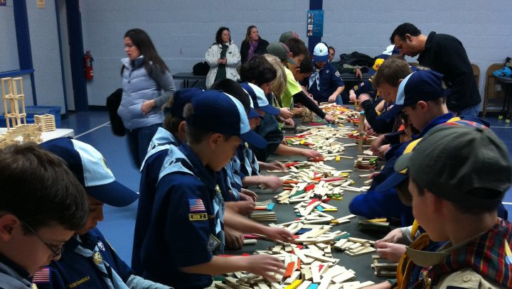 Boy Scouts engaged in sorting blocks before building a bridge