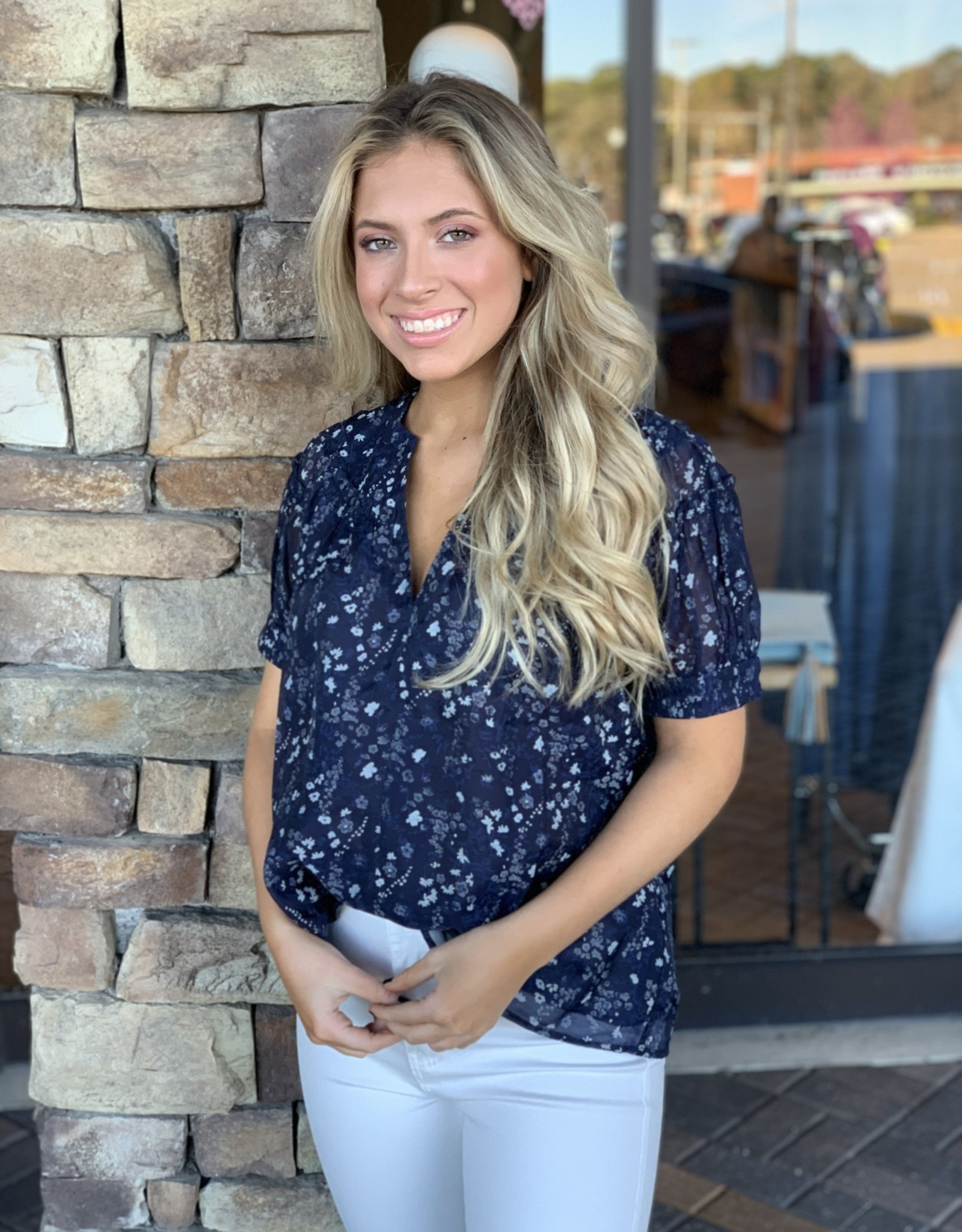 NAVY FLORAL PRINT TOP W/ RUFFLE