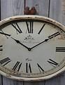Rustic Bird Oval Clock
