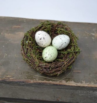 Decorative Bird nest swag with ivy and green foliage one blue egg in nest