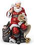 Sitting Santa With List