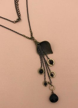 Edgy Petal Black Onyx and Brass Earthen Surge Necklace