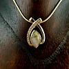 Ribbon and Diamonds 22K Gold in Quartz Pendant (#205)