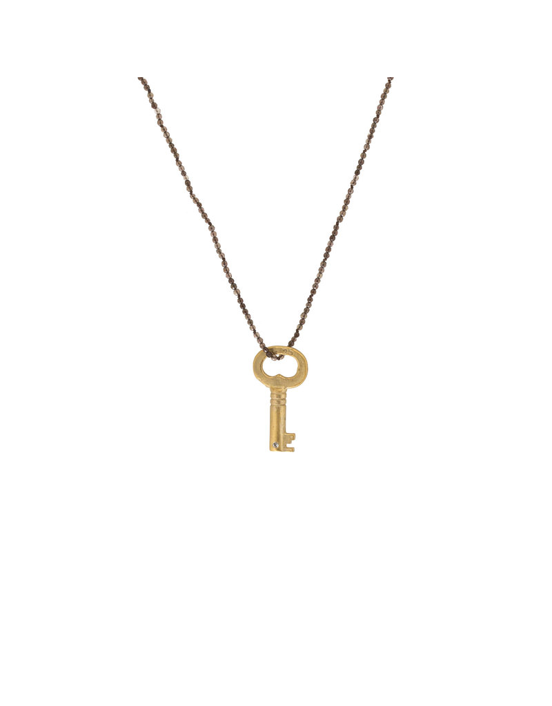 Antique Skeleton Key with Grey Sapphire in Golden Bronze